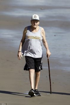 Relaxing: Ryan O'Neal looked in good spirits as he enjoyed a well-deserved stroll along Malibu beach on Monday Worst Celebrities, Celebrities Then And Now, Celebs, Old Man Fashion, Famous Tombstones, Ryan O'neal, Young Old, Malibu Beaches, Aging Gracefully