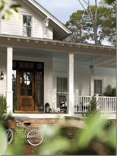 farmhouse. This is exactly what I want the front of the house to look like. Porch redo!