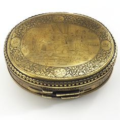 A FINE 18TH CENTURY DUTCH ENGRAVED BRASS OVAL DOUBLE-LIDDED TOBACCO BOX, CIRCA 1750