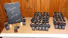 Mini jack daniels bottles as favors for 30th birthday party. With Thanks tags…