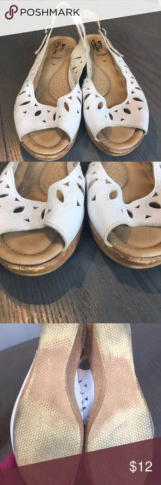 "White leather wedge sandals Used but in good condition.  White 2"" wedge with cutout detail. Blemish on toe fronts (pictured) Spring Step Shoes Wedges"
