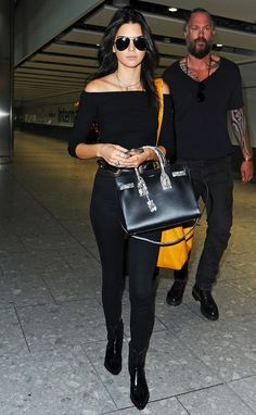 144 AIRPORT STYLE CELEBRITY PICS----Kendall Jenner seen arriving at London Heathrow Airport this morning