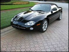 Auction Lot Kissimmee, FL Black with Black leather interior. Overall an excellent condition for 7 year old car. Jaguar Xk8 Convertible, Jaguar Daimler, Jaguar Cars, Automatic Transmission, Old Cars, Auction, Black Leather, Steel, Classic