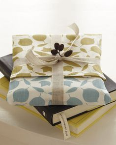 Wrapping idea- cookbooks wrapped in dish towels and top with a wooden spoon