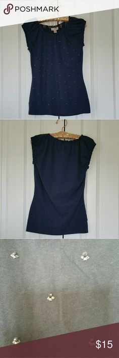 """▪Loft Navy Blue Embellished Front Top▪ Worn a few times... Embellishments on the front of the top... Elastic around the sleeves and the neck... Color is Navy blue... 95% cotton, 5% spandex... Measures 18"""" across the bust, 25"""" length from the shoulder down...  Sorry no trades... If you have any questions please ask... If you don't like the price please use the offer button...  """"Great Sense of Style"""" Have an amazing day! LOFT Tops Tees - Short Sleeve"""