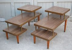"2 Mid century 3 tier laminate top end tables. 15.75""w x 30""d. Tiers are 9.5"", 15.75"" and 22""high. Tops are clean with no scratches or chips. Sides have some nicks. Brass support poles have some corrosion. Great for the starter apartment or waiting lounge. $95 for the pair."