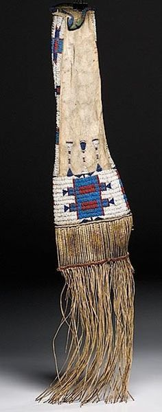native american, America, Arapaho beaded hide tobacco bag, late 19th century, sinew-sewn using glass bead colors of red white-heart, green, dark and medium blue, translucent blue, and white; recycled parfleche slats quilled in yellow, purple, and white; bottom edge with braided red wool and finished with thin hide fringe.