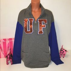 NEW PINK VS BLING UNIVERSITY OF FLORIDA SWEATSHIRT PINK VICTORIA'S SECRET   BLING HALF ZIP UNIVERSITY OF FLORIDA SWEATSHIRT, SEQUINS ALL OVER THE LETTERS AND FRONT POCKETS!!!   COLOR BLUE/GRAY   SIZE M   FAST SHIPPING!!!  ✅✅✅    Check out my other items! I am sure you will find something that you will love it! Thank you for watch!!!!!   Be sure to add me to your favorites list! PINK Victoria's Secret Tops Sweatshirts & Hoodies