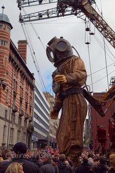 """French street theatre company Royal de Luxe brought three giant marionettes to participate in Liverpool's Sea Odyssey Giant Spectacular. The show was performed in the streets of Liverpool on April 20-22, 2012 and was part of the city's centenary commemoration of the Titanic disaster. In 2009, the same puppets performed collectively in """"La Géante du Titanic et le Scaphandrier"""" in Nantes, France."""