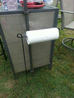 Garden flag hanger doubles as paper towel holder