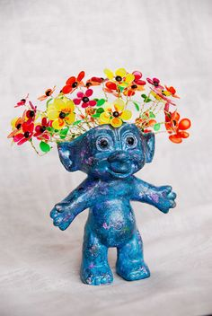 Altered Lucky Troll Doll with Lacquered Flowers by KitschUcopia, $26.95