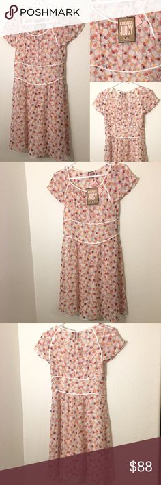 """Juicy Couture French Blossom Posey Dots Dress Sz 2 Juicy Couture French Blossom Posey Dots Dress New With Tags  size 2.  Retailed for $298.  100% Silk, lined with a full slip. Gorgeous dress for a party looking ahead toward Valentine's Day and Spring. Length 35"""", Waist measured flat across 14"""", chest 15"""". Side zipper is 8"""" long. From my Non smoking home. Juicy Couture Dresses"""