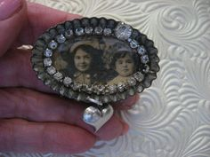 Brooch repurposed from a vintage tiny tart pan (patty pan) and antique real photo of two little sisters.