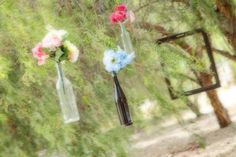 Ceremony under the trees - we hung wine bottles with flowers and large vintage picture frames for the backdrop.