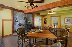 A wood stove is the centerpiece of this area which can serve as a game room or a relaxed dining area.