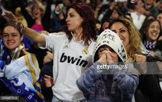 Real Madrid football club supporters celebrate their team's victory...
