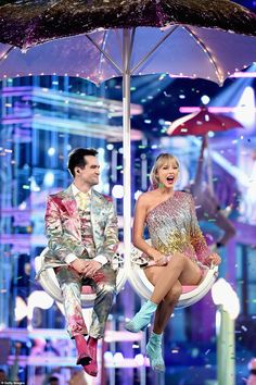 Top of the world: The singer took to the stage with Panic! At the Disco's Brendon Urie, 32...