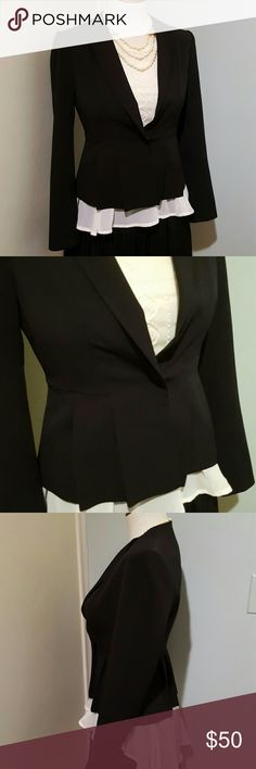 """Ann Taylor Black Pleated Peplum Blazer 0 Petite Gorgeous on-trend black Ann Taylor blazer. Cropped length, single snap closure, with tailored seaming for a slim fit, and a peplum waist with wide pleats. Size 0 Petite.  Fully lined.  Polyester/spandex blend.  Freshly dry-cleaned, and in excellent used condition showing very little wear.  32"""" bust, 14.5"""" shoulder to shoulder, 22.5"""" sleeve, 28"""" waist. Ann Taylor Jackets & Coats Blazers"""