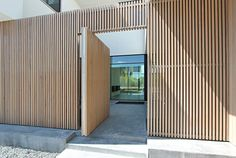 contemporary slatted wood entry gate