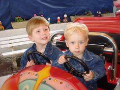 boys at a little fairground ride, France