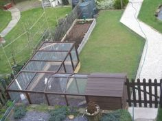 L-shaped Chicken Run to fit in the corner of the garden.