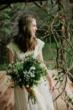 relaxed, beautiful bride and wildflower bouquet