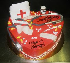 Heart shaped nursing themed cake with 3D nurse's hat, stethoscope, band aids, pills, etc.