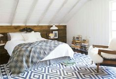 ●Country Living - Create a rustic yet stylish look in your bedroom this year for an on-trend makeover that's easy to achieve. This bedroom, spied on Coco + Kelley, exudes warmth, while still maintaining a certain level of sophistication. The ikat rug and ultra cozy chair add to the charm of the room.