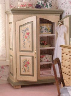 The chaise is by Carol's Mini Fabrications. I made the hat boxes from card stock and scaled-down Laura Ashley wallpaper borders. The night dress on the armoire is by Miniature Mademoiselle, and the one on the bed was made in Joann Roberts class. Roses are by Bernice Gordon. Lucy Pannute painted the lingerie chest.