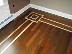 dark hardwood floors with light maple border
