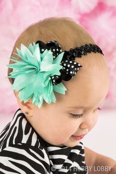 What's black and teal and snuggly all over? Your beautiful bow-bedecked baby!