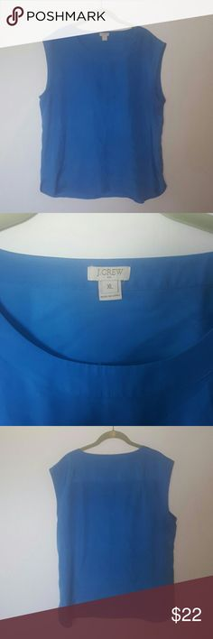 """J. Crew sleeveless blue blouse XL Worn 2 or 3x.  J. Crew sleeveless blue blouse, size XL.  This is such a pretty medium ocean blue.  100% polyester.  Fabric has a slight sheen.  Wrinkled in the photos because it has been in my """"sell"""" pile for a while, but it irons or steams out to be smooth.  Boxy, loose fit.  26.5"""" long, 22"""" across. J. Crew Tops Blouses"""