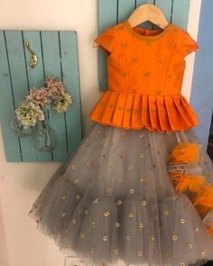 Kids designer dresses - Doll up your princess from us This spring wedding season , try something different in these trouser sarees , make yourself free Go easy… Kids Party Wear Dresses, Kids Dress Wear, Kids Gown, Dresses Kids Girl, Dress Party, Kids Frocks Design, Baby Frocks Designs, Baby Dress Design, Frock Design