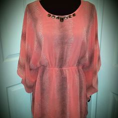 DG2 Peach Colored Chiffon Tunic Top Pretty peach color; embellished neckline; cinchable tie at waist; semi-shear, but is lined  with a lightweight material; will easily fit large & XL sizes; cool & flowing for summer weather; excellent condition, NWT. Diane Gilman Tops