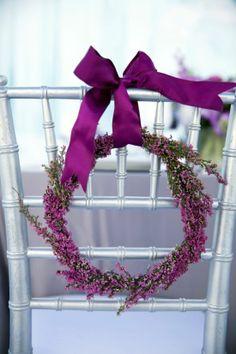simple ribbon and wreath for chair decor  #winterwedding #weddingreception #weddingchicks http://www.weddingchicks.com/2014/04/03/frozen-wedding-ideas/
