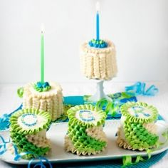 Mini birthday cakes with swirling ruffles in ombre shades of green and blue from Bakingdom