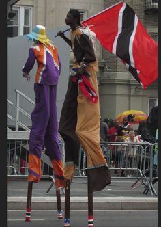 Stilt walkers at Brooklyn's famous Labor Day parade down Eastern Parkway. Image © E. Freudenheim 2013