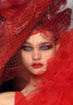 Her face is placed between two parallels, her hat and dress! I like her makeups too. | red is the color