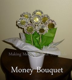 Money bouquet -- uses folded bills & choc coins. Cute & easy idea! (esp for Tweens & teens)