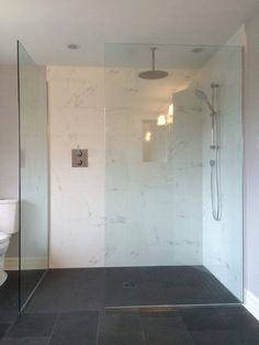 Custom 10mm clear tempered glass shower enclosure without a door or sill. www.grandriverglass.com