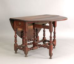 """Pook & Pook. October 24th & 25th 2008. Lot 490.  Estimated: $3K - $4K. Realized Price: $11,700. Delaware Valley William & Mary walnut gateleg table, ca. 1745, with an oval dropleaf top and a single long drawer, 29"""" h., 45 1/2"""" w."""