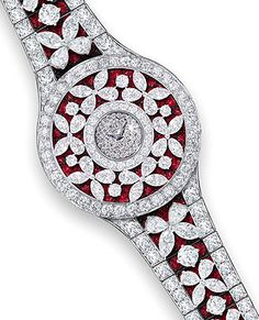 Diamonds form butterflies over the sea of rubies in one of the new watches of Graff.