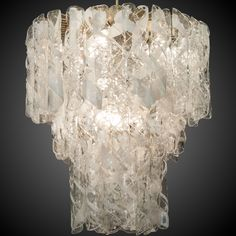 Extra Large Mazzega Three Tier Chandelier with Swirled Glass Elements  --  Circa 1960s Murano glass chandelier by Mazzega consists of three tiers of clear and white curled glass elements suspended from a brass frame. New electrical wiring for US standards.  --   Item:  5564  --  Price:   $8995