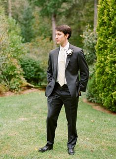 Black suit and yellow tie, wedding with Southern charm.  Photo by Ali Harper.