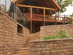 """Incorporate stairs into your retaining walls to create a eye-catching backyard entrance. Product featured: Highland Stone® 6"""" Retaining Wall System"""