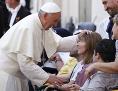 Pope greets woman with disability after Mass in St. Peter's Square at Vatican  Pope Francis blesses a woman as he greets people who have disabilities following Mass in St. Peter's Square at the Vatican June 17. The Year of Faith Mass concluded a weekend of events calling attention to care for the aged, the sick, the unborn and those with disabilities. (CNS photo/Paul Haring)