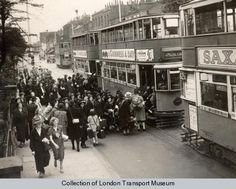 Children from the Charles Edward Brooke (girls) School boarding trams in Camberwell New Road. The children are to be taken to Waterloo station for evacuation. Some soldiers can be seen further along the pavement, talking to a civilian.  Photographed by Topical Press, 1 Sep 1939