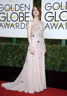 Emma Stone attended the 74th Golden Globes in a Haut eCouture gown especially designed for her by Creative Director Pierpaolo Piccioli.