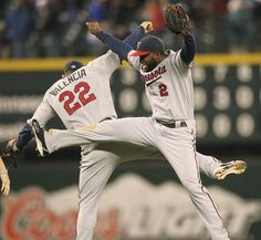 Denard Span #2 and Danny Valencia #22 of the Minnesota Twins celebrate after defeating the Seattle Mariners 3-2 at Safeco Field on May 4, 2012