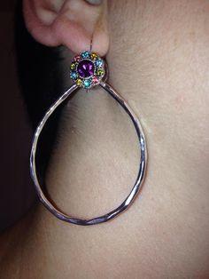 Premier designs, combining small post earrings and fishhook hoop earrings.